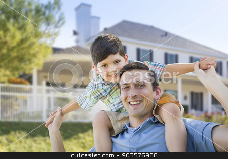 Mixed Race Father and Son Piggyback in Front of House stock photo, Mixed Race Father and Son Playing Piggyback in Front of Their House. by Andy Dean