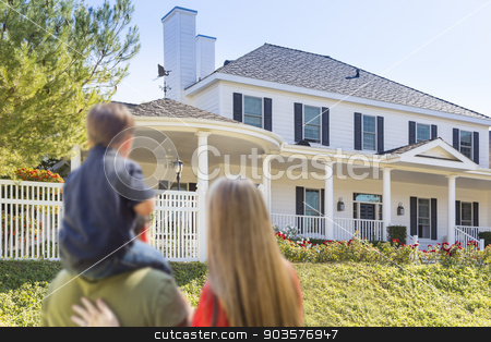 Mixed Race Young Family Looking At Beautiful Home stock photo, Mixed Race Young Family Looking At Beautiful New Home. by Andy Dean