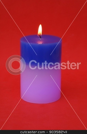 lit candle stock photo, new candle which changes it's color by time when it is burning by Saphire Ovadia