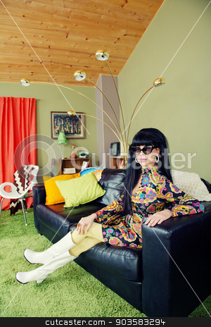Calm Lady Sitting on Sofa stock photo, Calm groovy woman sitting on leather sofa by Scott Griessel