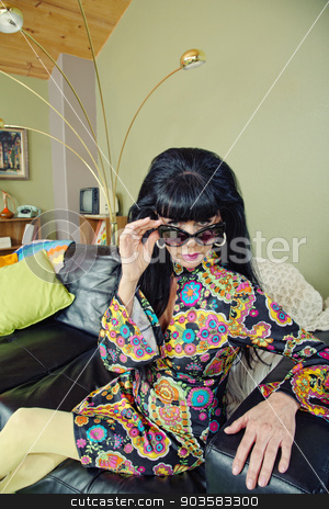 Woman Looking Over Sunglasses stock photo, Groovy woman in 1960s fashion looking over sunglasses by Scott Griessel