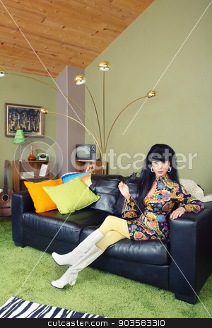 Pretty Woman on Sofa stock photo, Laid back pretty retro woman sitting on leather sofa by Scott Griessel