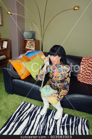 Skeptical Female on Phone stock photo, Cute retro 1970s female with telephone on sofa by Scott Griessel