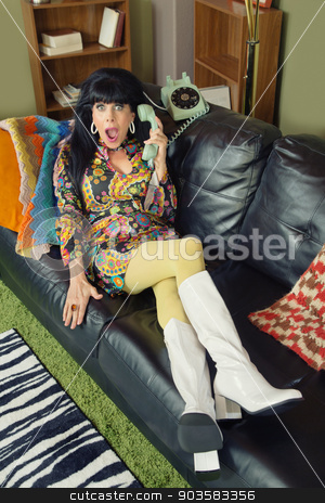 Amazed Woman on Phone stock photo, Amazed pretty woman on sofa holding telephone by Scott Griessel