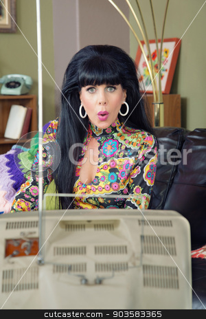 Concerned Woman Watching TV stock photo, Beautiful woman in paisley concerned with television by Scott Griessel