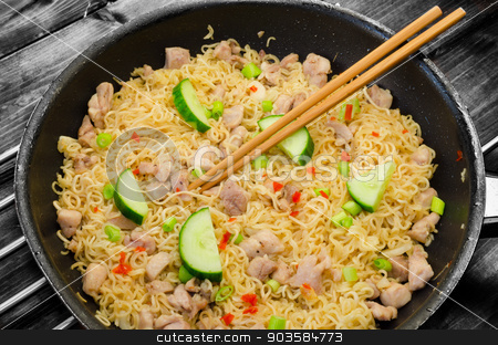 Chinese noodles with chicken stock photo, Chinese noodles with chicken on pan and wood table by Peteer