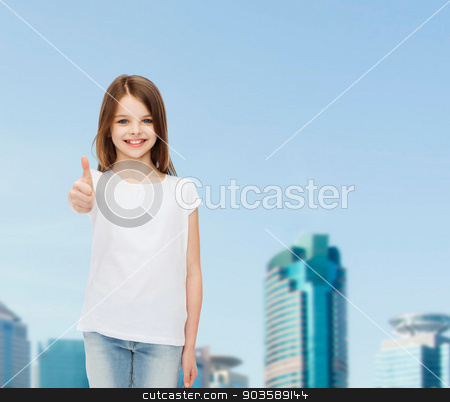 smiling little girl in white blank t-shirt stock photo, advertising, childhood, city, gesture and people concept - smiling girl in white t-shirt showing thumbs up over business center background by Syda Productions