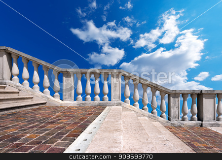Marble Staircase on Blue Sky with Clouds stock photo, Staircase in white stone and marble with balustrade on blue sky with clouds by catalby