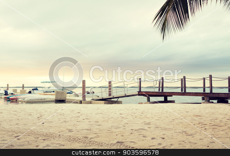 boats moored to pier stock photo, beach, summer, travel and leisure concept - boats moored to pier by Syda Productions