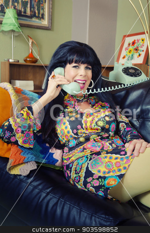 Smiling Lady on Phone stock photo, Happy smiling woman in paisley on rotary telephone by Scott Griessel