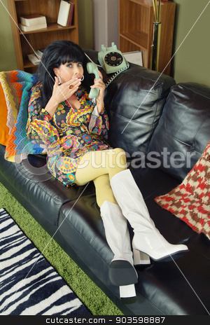 Giggling Woman on Phone stock photo, Giggle mature white woman in 1960s style on phone by Scott Griessel