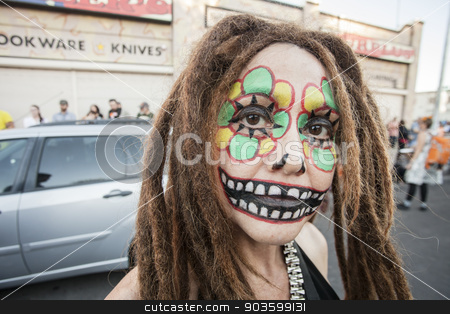 Woman with Dreadlocks in Dia De Los Muertos Makeup stock photo, TUCSON, AZ/USA - NOVEMBER 09: Unidentified young woman with dreadlocks facepaint at the All Souls Procession on November 09, 2014 in Tucson, AZ, USA. by Scott Griessel