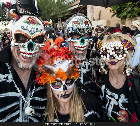 People in Dia De Los Muertos Masks and Makeup stock photo, TUCSON, AZ/USA - NOVEMBER 09: Four unidentified people in masks at the All Souls Procession on November 09, 2014 in Tucson, AZ, USA. by Scott Griessel