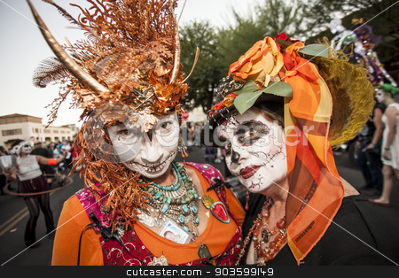 Women in Dramatic Dia De Los Muertos Makeup stock photo, TUCSON, AZ/USA - NOVEMBER 09: Two undientified women in facepaint and costumes at the All Souls Procession on November 09, 2014 in Tucson, AZ, USA. by Scott Griessel
