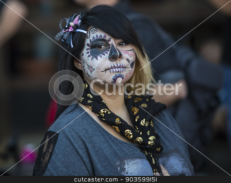 Young woman in Dia De Los Muertos Makeup stock photo, TUCSON, AZ/USA - NOVEMBER 09: Unidentified young woman in facepaint at the All Souls Procession on November 09, 2014 in Tucson, AZ, USA. by Scott Griessel