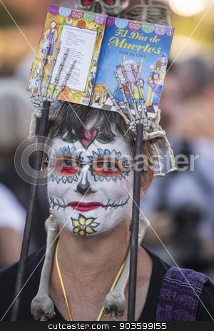 Woman in Dia De Los Muertos Makeup stock photo, TUCSON, AZ/USA - NOVEMBER 09: Unidentified woman in facepaint at the All Souls Procession on November 09, 2014 in Tucson, AZ, USA. by Scott Griessel