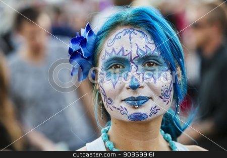 Pretty Woman in Dia De Los Muertos Makeup stock photo, TUCSON, AZ/USA - NOVEMBER 09: Unidentified young woman in blue facepaint at the All Souls Procession on November 09, 2014 in Tucson, AZ, USA. by Scott Griessel