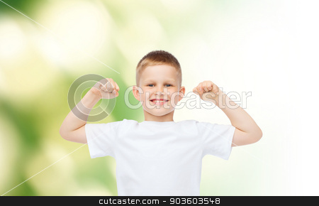 happy little boy in white t-shirt flexing biceps stock photo, advertising, ecology, people and childhood concept - smiling little boy in white blank t-shirt flexing biceps over green background by Syda Productions