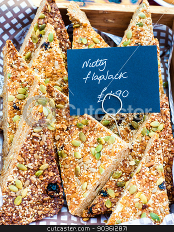 Flapjack British slices with sesame and pumpkin seeds in the market stock photo, Flapjack British slices with sesame and pumpkin seeds in the market by Constantin Stanciu