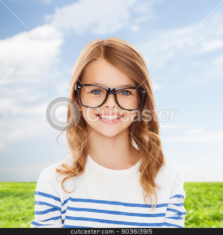 smiling cute little girl with black eyeglasses stock photo, education, school and vision concept - smiling cute little girl with black eyeglasses by Syda Productions