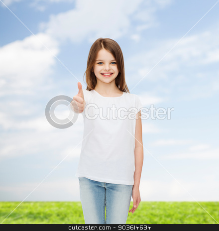 smiling little girl in white blank t-shirt stock photo, advertising, childhood, summer, gesture and people concept - smiling little girl in white blank t-shirt showing thumbs up over natural background by Syda Productions