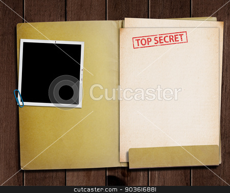 Top secret folder. stock photo, folder with TOP SECRET stamped across the front page and a blank photograph  by Pablo Caridad