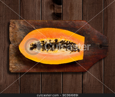 Sliced fresh papaya on wooden background  stock photo, Sliced fresh papaya on wooden table.  by Pablo Caridad