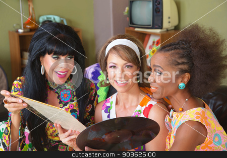 Women Looking at Records stock photo, Group of three diverse 1970s style mature women with record by Scott Griessel
