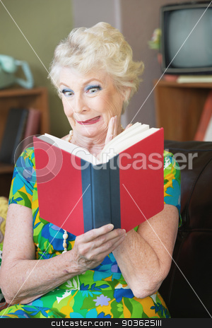 Uneasy Woman Reading stock photo, Uneasy single senior woman in green reading a book by Scott Griessel