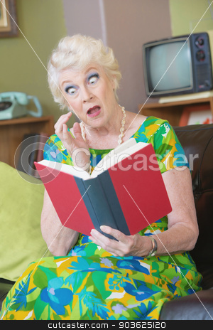 Astonished Woman Reading Book stock photo, One astonished senior female reading a book by Scott Griessel