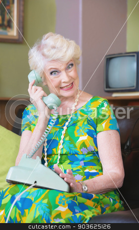 Smiling Woman on Phone stock photo, Happy senior woman in green on rotary telephone by Scott Griessel