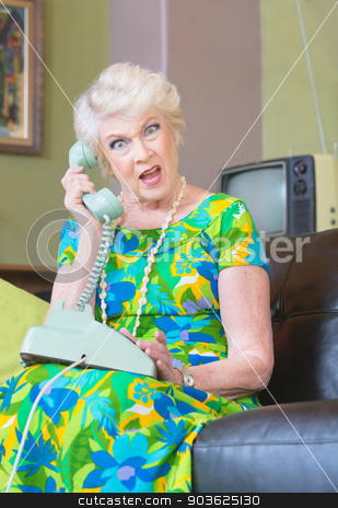 Angry Senior Woman on Phone stock photo, Angry European senior female on phone in 1960s fashion by Scott Griessel