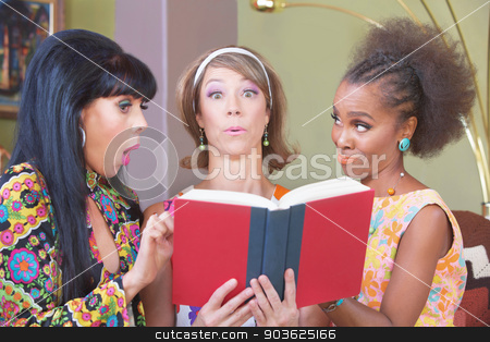 Three Women Studying stock photo, Three cute mature women impressed with a novel by Scott Griessel