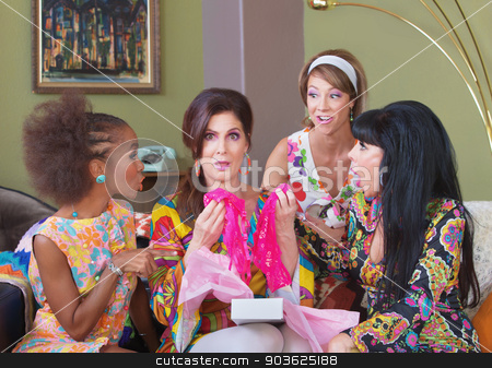 Shocked Woman Holding Underwear stock photo, Shocked woman holding pink underwear at party by Scott Griessel