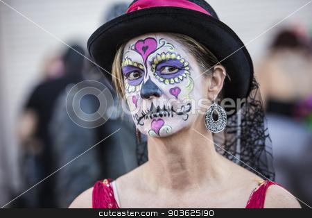 Female in Dia De Los Muertos Makeup stock photo, Serious female in hat with makeup for Dia De Los Muertos by Scott Griessel