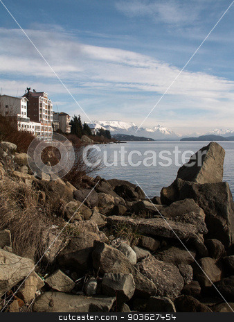 Bariloche Mountain And Lake stock photo, Snow capped mountains loom over a lake-side hotel in Bariloche, Argentina. by Jean-Paul Bagur