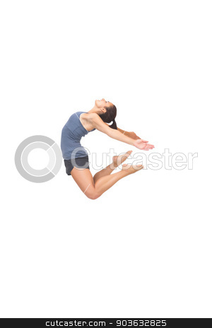 Flexible sporty brunette jumping in the air stock photo, Flexible sporty brunette jumping in the air on white background by Wavebreak Media