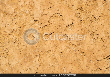 Clay soil texture background, dried surface stock photo, Dark yellow clay soil texture background, dried cracked surface by Serghei Starus