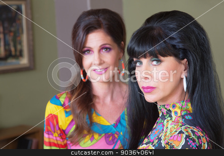 Serious Lady with Friend stock photo, Serious Caucasian woman in paisley with cute friend by Scott Griessel