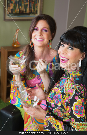 Two Women Smoking and Drinking stock photo, Smiling women smoking cigarettes and drinking martinis by Scott Griessel