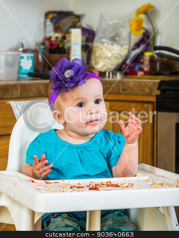 Cute Messy Baby stock photo, Messy baby eats her breakfast in the kitchen by Scott Griessel