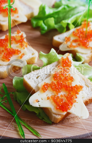 festive sandwiches stock photo, sandwiches in the shape of a christmas tree with cheese and caviar. holidays and events by Jevgeni Proshin