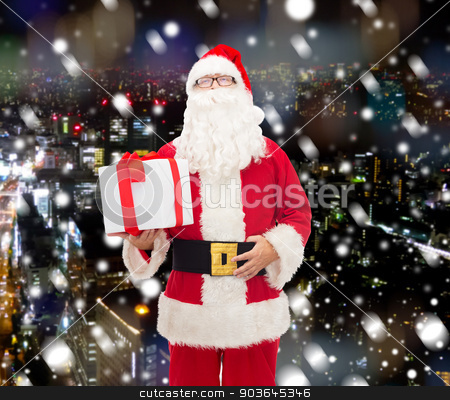 man in costume of santa claus with gift box stock photo, christmas, holidays and people concept - man in costume of santa claus with gift box over snowy night city background by Syda Productions