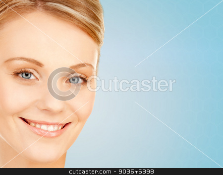 beautiful young woman face stock photo, beauty, people and health concept - beautiful young woman face over blue background by Syda Productions