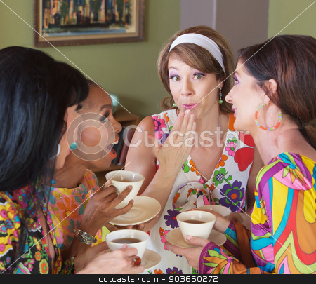 Embarrassed Woman with Friends Drinking Tea stock photo, Cute European woman with hand by mouth talking with friends by Scott Griessel