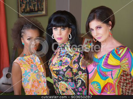 Three Serious Beautiful Women stock photo, Three serious beautiful women in 1960s fashion by Scott Griessel