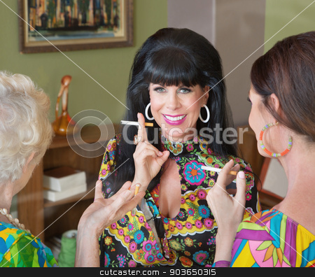Smiling Lady Smoking with Friends stock photo, Smiling Caucasian female with friends smoking cigarettes by Scott Griessel