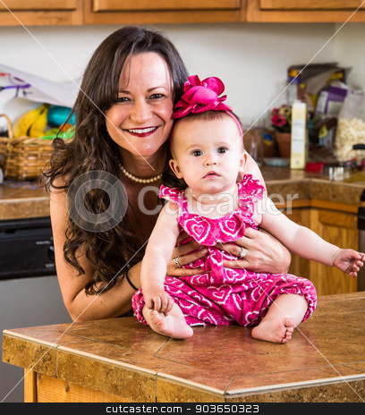 Mother Poses With Her Baby stock photo, A mother in the kitchen poses with her baby by Scott Griessel