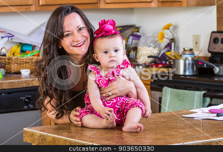 Woman and Baby in Kitchen stock photo, Smiling woman holds her baby in the kitchen by Scott Griessel