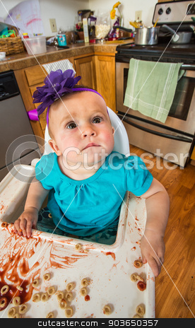 Curious Looking Baby stock photo, Curious baby in kitchen is looking upwards by Scott Griessel